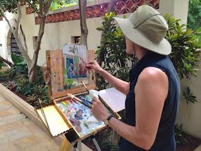 Photo: Chris Kling at work / painting fellow artist Manny J. at work.