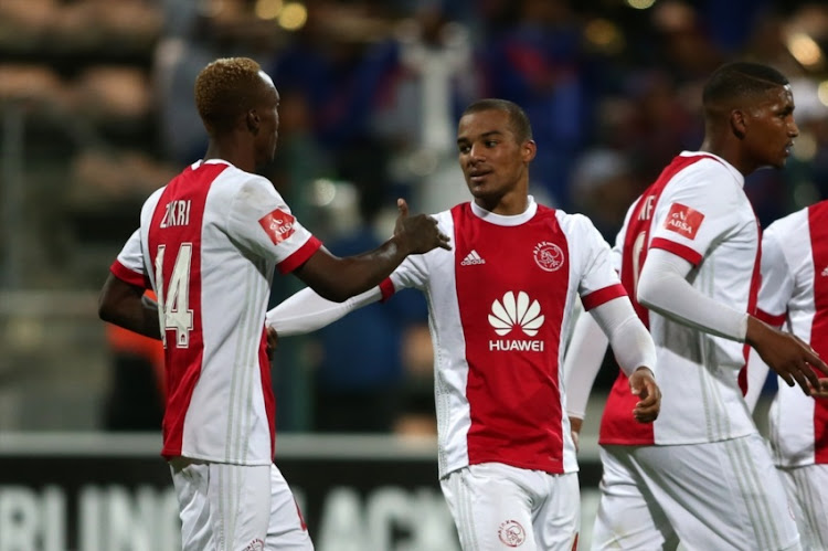Yannick Zakri of Ajax Cape Town congratulates Fagrie Lakay of Ajax Cape Town for scoring during the Absa Premiership match between Ajax Cape Town and SuperSport United at Athlone Stadium on February 28, 2018 in Cape Town.