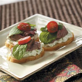 Beef Canapes with Cucumber Sauce.