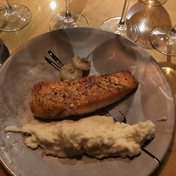 Salmon with celery root purée and cipollini onions.