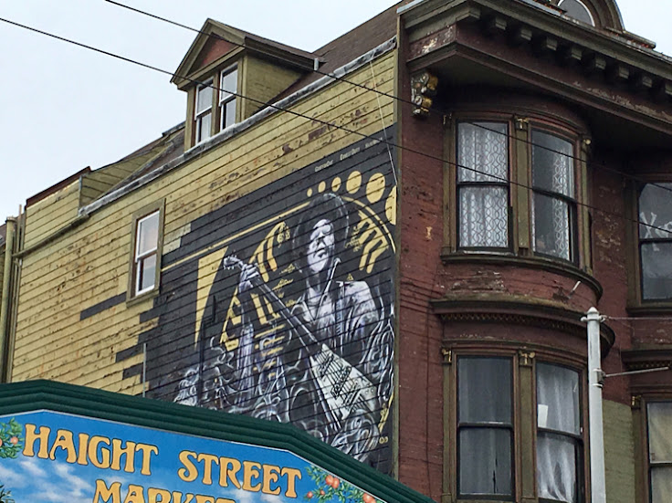 The mural of Hendrix on the west side of 1524 Haight St.