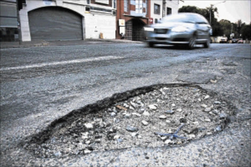 HOLEY CITIES: The State is obliged to maintain facilities such as roads, but potholes the size of fishponds are a common sight on South Africa roads - a sign of failure to carry out what the State is meant to do. Photo: Daniel Born