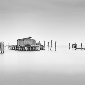 Pellestrina 3 by John Holmes - Black & White Landscapes ( calm, water, smoth, nikon d750, monochrome, black and white, low key, pellestrina, venice, sea, long exposure, minimal, fishing, italy, fishing huts )