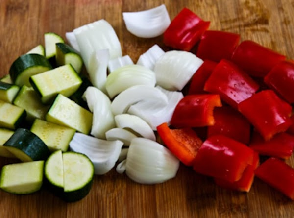 To prepare vegetables, combine 1/4 cup vinaigrette, zucchini, and bell peppers in a large...