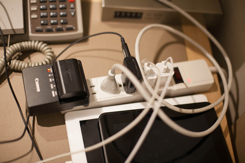 A pastiche of cords compete for space in this power strip (multi-outlet extension cord) brought by a guest on Viking Star.