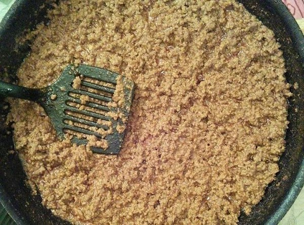 In large skillet: Brown and cook ground beef. Add the 3 packages of taco...