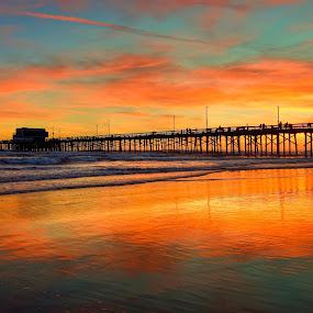 Newport Beach Pier by Eddie Yerkish - Landscapes Sunsets & Sunrises ( sand, orange, reflection, waterscape, waves, california, ocean, newport, beach, seascape, yellow, landscape, blue, outdoors, pier )