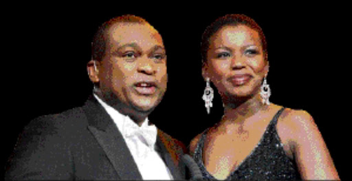 SHOULDER TO SHOULDER: Prominent sports presenters Robert Marawa and Carol Manana. Pic. Sydney Seshibedi. 24/06/2009. © Sunday Times.