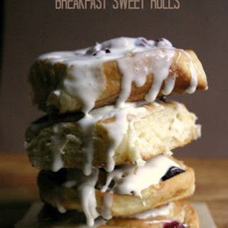 Cranberry Coconut Sweet Rolls with Spiked Eggnog Cream Cheese Glaze