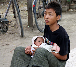 Photo: Year 2 Day 55 -  Local Lad with His Baby Sister