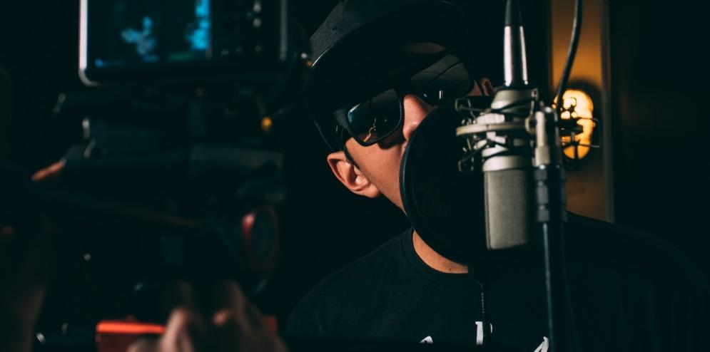 Hip hop artist recording a song in the studio