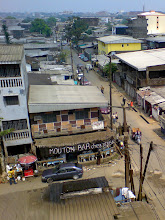 Photo: Streets of Douala and a cool corner bar