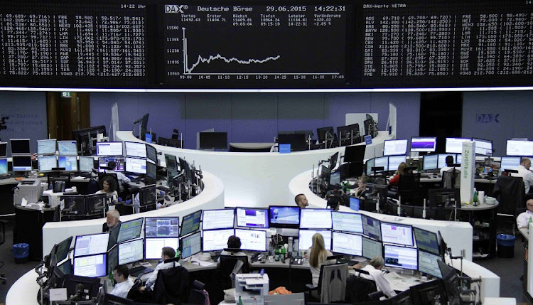 Traders at work at the Frankfurt stock exchange in Germany. File picture: REUTERS