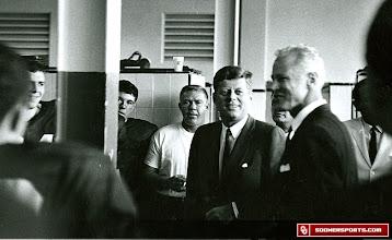 Photo: President John F. Kennedy visits the Sooner locker room prior to the 1962 Orange Bowl game.
