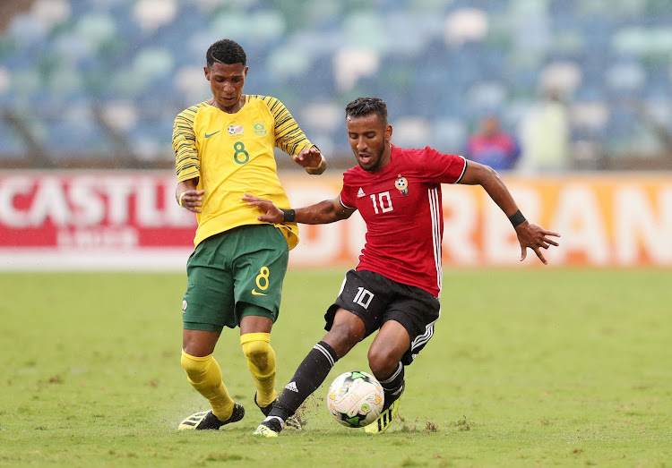 Bafana Bafana debutant Vincent Pule (L) tussles for the ball with Hamdou Elhouni (R) of Libya during the 2019 African Cup Of Nations qualifier at the Moses Mabhida Stadium, Durban on September 8 2018.