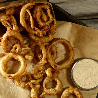 Crazy-Crisp Cajun Onion Rings with Spicy Mustard Aioli.