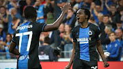 South African star forward Percy Tau (R) celebrate with his Club Brugge teammate during a match.