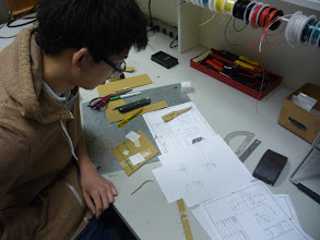 Photo: Steven working on the knee restraint design.