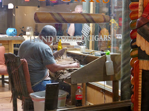 Photo: A cigar shop in Ybor City - the fellow is hand-rolling cigars.