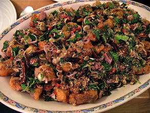 """Photo: northeastern-style crisp-fried catfish """"lahb"""" with aromatic herbs and toasted rice"""