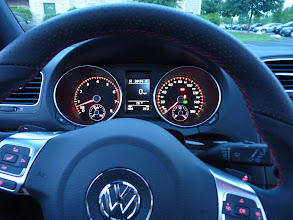 Photo: The two buttons on top/behind the steering wheel are the shift paddles.  - for downshifts on the left, + for upshifts on the right.