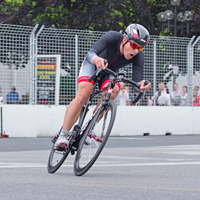 Chin Picnic Bike Race Canada Day by Brian Carson - Sports & Fitness Cycling ( person, brian carson, toronto, cycling, street, intensity, vibrant, chin picnic, recreation, racers, race, people, city, bicycle, bikes, biker, movement, lifestyle, action, power, the learning curve photography, july 1, motion, move, cycle, canada, wheels, elite, fun, bike race, professional, bicyclist, bicycles, cyclists, biking, bicycle race, racer, active, fast, www.thelearningcurve.ca, outside, athletic, fitness, bicycling, exercise, road, blur, rider, bike, cne, criterium, transport, dramatic, men, exhibition, downtown, athlete, man, activity, cyclist, extreme, rush, speed, male, sport, urban, blurred, canada day, outdoor, pro, competitive, competitor, masters, competition,  )