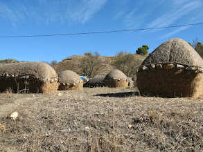 Photo: Typical sight all across Morocco, hay stacks weighed down with stones