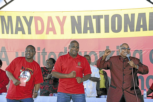 Better days: President Jacob Zuma, right, leads tripartite alliance leaders Cosatu president Sdumo Dlamini and SACP general secretary Blade Nzimande in song at a May Day rally at Galeshewe Stadium in Kimberley, Northern Cape, in 2015.Picture: SUPPLIED