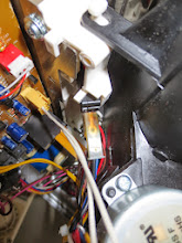 Photo: One of the microwave oven's three safety interlock micro switches had gone bad: witness the arcing on the switch contact.