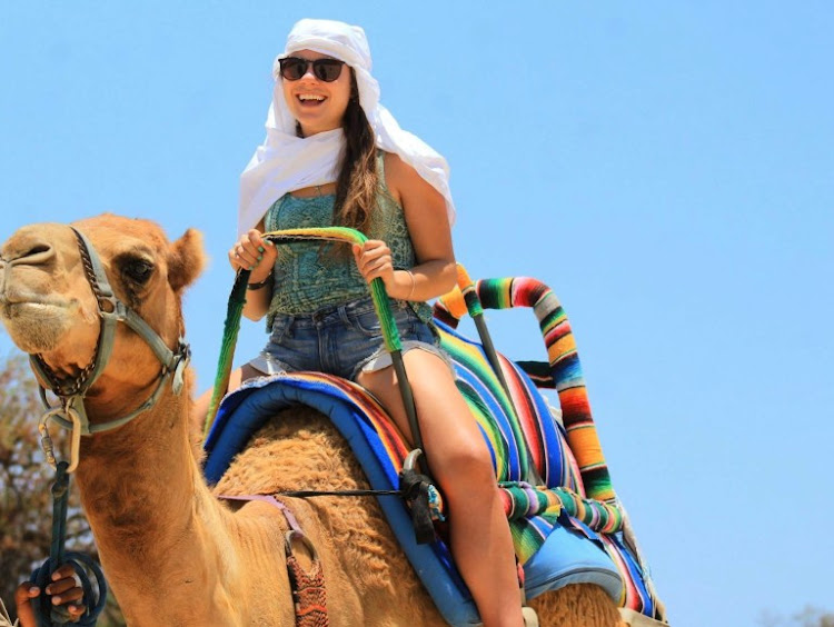 That's me, in my head garb and shades, during my first camel ride.