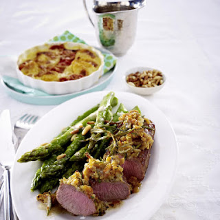 Lamb Steaks with Rosemary Crumble Served with Potato Gratin and Asparagus.