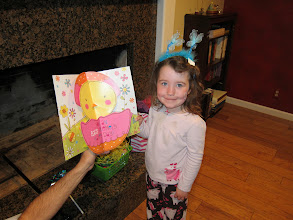 Photo: Fianna with one of Aunt Dee's cards, Easter 2013