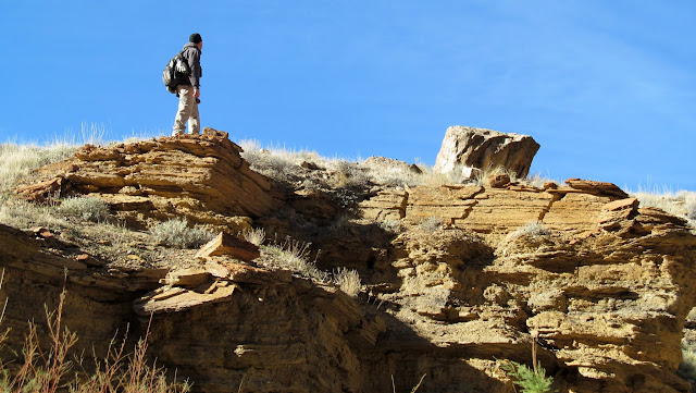 Wade checking out a cairn above the canyon
