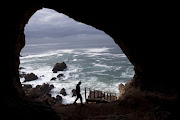 A view of the sea and rocks from inside a cave at Pinnacle Point.