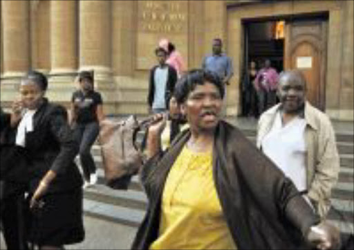 02/09/2009. An angry relative of the Buyisiwe rape accused threatens to hit a photographer outside the Johannesburg high court. buyisiwe was gang raped in 2005 by eight men. PIC: VATHISWA RUSELO.02/09/2009. © SOWETAN