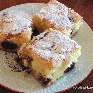 Romanian Pound Cake with Fruits and Almond Flakes.