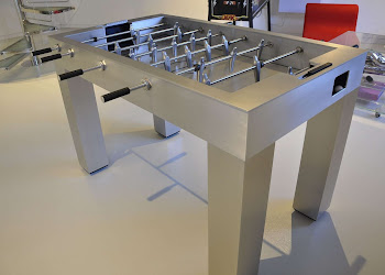 an iron foosball table in a garage