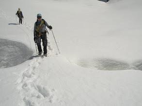 Photo: Bill on a narrow snow bridge coming down through the Linda's crevasses.