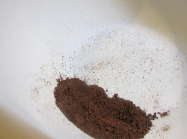 Crush coffee granules in a small bowl.