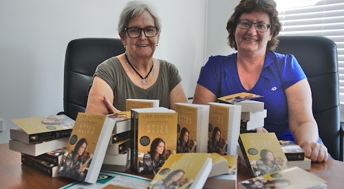 Narrabri Dementia Friendly Town Committee chairwoman Dot Craig and Narrabri Shire Library manager Jenny Campbell hope as many locals as possible get a chance to read Still Alice. Inset, the sticker on the inside of the book asks readers to either bring the book back so someone else can read it or pass it on directly.