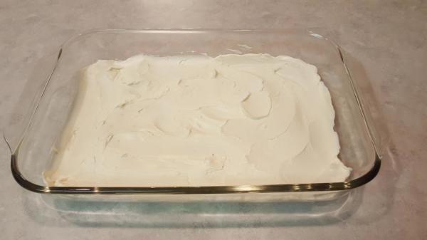 Layer the bottom of pan with cream cheese by smoothing  out the cream...