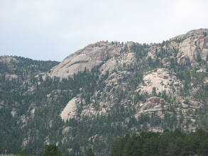 Photo: Part of Lumpy Ridge near Estes. Long ago I hurt my hands penduluming beneath the arch of the formation on the left