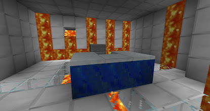 Photo: Here you can see the original logo that started WUCORP.  The W is made up of 3 lava spawners inset into the wall, and there's a pit beneath the letters to prevent them from spilling onto the floor.  By Tim F.
