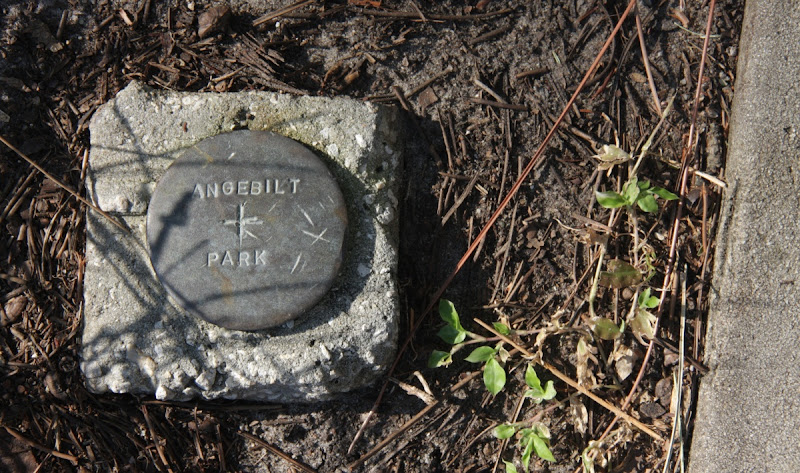 Photo: Benchmark in Kaley Square Park, formerly Angebilt Park, located in the NW corner of the park very near the W side of the concrete sidewalk, near metal park benches