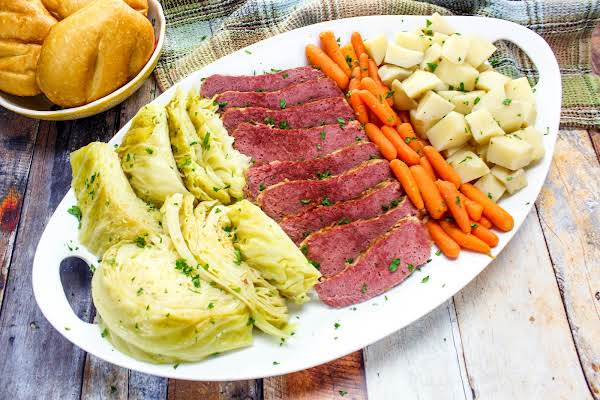 A Platter Of Corned Beef And Cabbage, Potatoes And Carrots.