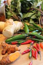 Photo: Clockwise from bottom left: Turmeric root, galangal, Vietnamese coriander, serrano and bird's eye chili peppers