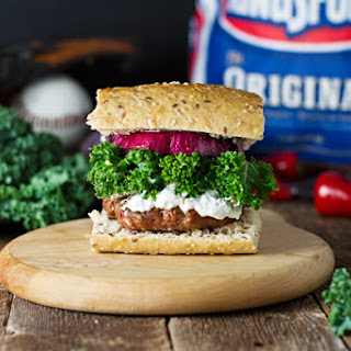 Red Pepper & Kale Beef Burgers w/ Grilled Onions & Goat Cheese.