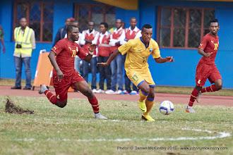 Photo: Patrick SIBOMANA (11) powers between Wakaso Mubarak (11) and Harrison Afful (12)  [Rwanda Vs Ghana AFCON2017 Qualifier, 5 Sep 2015 in Kigali, Rwanda.  Photo © Darren McKinstry 2015