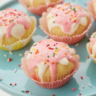 Glazed Strawberry-Filled Doughnut Cupcakes.