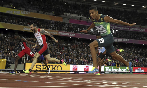 SA's Wayde van Niekerk crosses the line milliseconds behind Turkey's Ramil Guliyev and ahead of Jereem Richards of Trinidad and Tobago to take silver in the 200m final at the world championships in London on August 10 2017. Picture: REUTERS